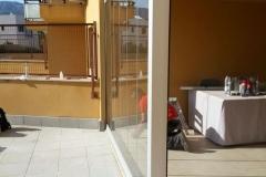 Cerramiento de porche con cortina de vidrio en Hospitalet de l'Infant